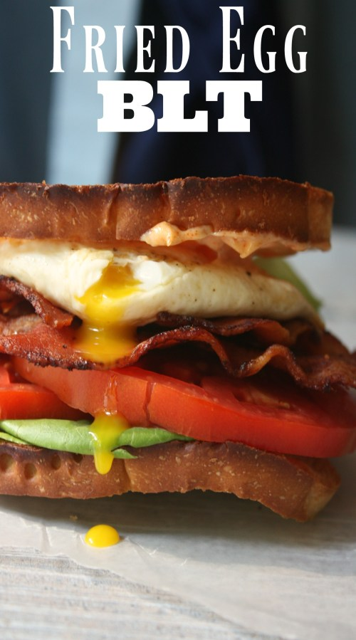 Fried Egg BLT Sandwich recipe. Layers of Bacon, Lettuce and Tomato topped with a fried egg with a runny yolk and smoked paprika mayo.