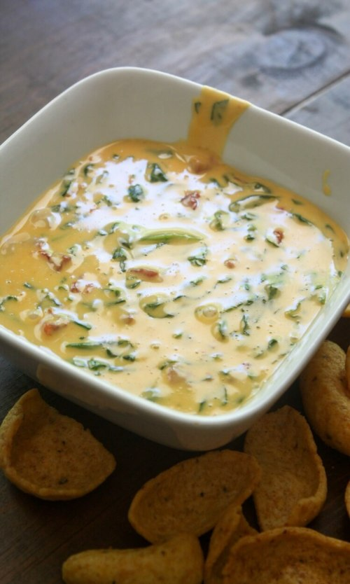 10 Super Cheesy Dips including this Slow Cooker Spinach Dip.