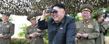 North Korean leader Kim Jong Un looks through a pair of binoculars during an inspection of the Hwa Islet Defence Detachment standing guard over a forward post off the east coast of the Korean peninsula, in this undated file photo released by North Korea's Korean Central News Agency (KCNA) in Pyongyang on July 1, 2014. REUTERS/KCNA/Files