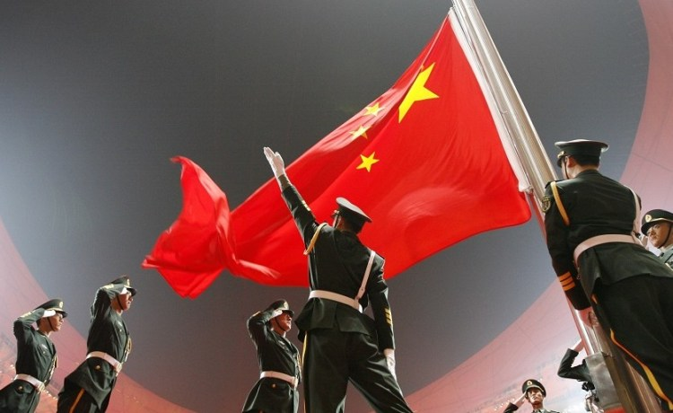 China's national flag is raised during the opening ceremony of the Beijing 2008 Olympic Games at the National Stadium in this August 8, 2008 file photo. REUTERS/Jerry Lampen/Files