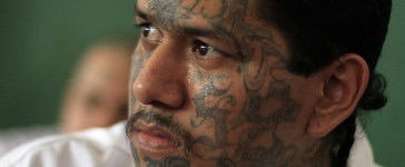 Walter Geovani Salguero, 30, an inmate and member of El Salvador's Mara Salvatrucha (MS-13) gang, participates in a pledge event during a news conference at the Sonsonate jail