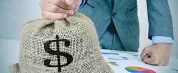 Bag of money bribe (Shutterstock)