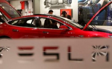 A man looks around Tesla Motors' Model S P85 at its showroom in Beijing January 29, 2014. REUTERS/Kim Kyung-Hoon/File Photo