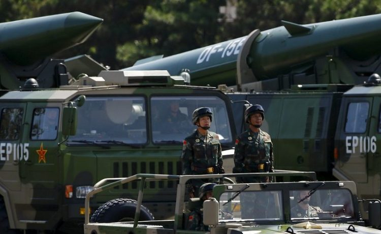 Military vehicles carry DF-15B short-range ballistic missiles during the military parade to mark the 70th Anniversary of the end of World War Two, in Beijing, China, September 3, 2015. REUTERS/Damir Sagolj