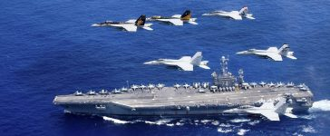 A combined formation of aircraft from Carrier Air Wing (CVW) 5 and Carrier Air Wing (CVW) 9 pass in formation above the Nimitz-class aircraft carrier USS John C. Stennis (CVN 74) in the Philippine Sea on June 18, 2016. Courtesy Steve Smith/U.S. Navy/Handout via REUTERS
