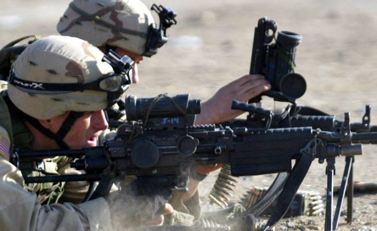 A U.S. soldier from the Charlie Company, 2nd Battalion, 504th Parachute Infantry Regiment fires his ..