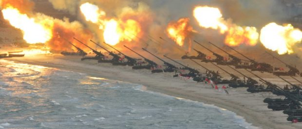 Artillery pieces are seen being fired during a military drill at an unknown location, in this undated photo released by North Korea's Korean Central News Agency (KCNA) on March 25, 2016. REUTERS/KCNA/File