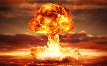 A nuclear bomb detonates on the ocean. Source: Shutterstock/Romolo Tavani