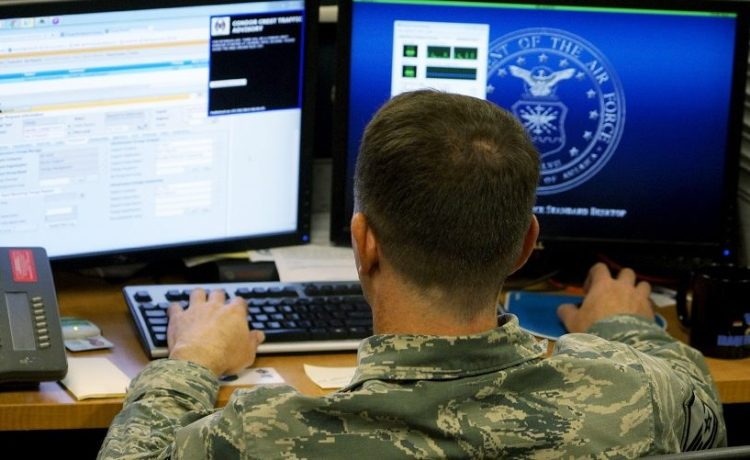 A U.S. Air Force airman works at the 561st Network Operations Squadron (NOS) at Petersen Air Force Base in Colorado Springs
