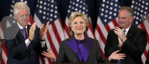 Democratic presidential candidate Hillary Clinton, with her husband, former U.S. President Bill Clinton, (L), and her Vice-President running mate Tim Kaiine (R), applaud at her concession speech to President-elect Donald Trump in New York, U.S., November 9, 2016. REUTERS/Carlos Barria