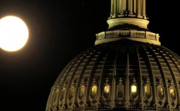 The supermoon rises over the United States Capitol dome in Washington, U.S., November 13, 2016. REUTERS/Gary Cameron