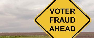 Caution Sign - Voter Fraud (Shutterstock/Jim Vallee)
