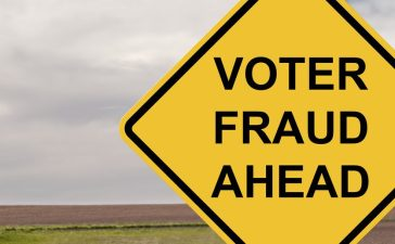Caution Sign - Voter Fraud (Shutterstock/Jim Vallee)