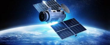 Communications Satellite orbiting and relaying information data back to earth. 3D Illustration. (Shutterstock.com/solarseven)