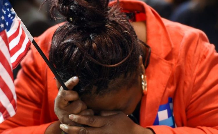 Marta Lunez, supporter of US Democratic presidential nominee Hillary Clinton, reacts to elections results during election night at the Jacob K. Javits Convention Center in New York on November 8, 2016. (DON EMMERT/AFP/Getty Images)