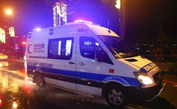 An ambulance arrives near a nightclub where a gun attack took place during a New Year party in Istanbul