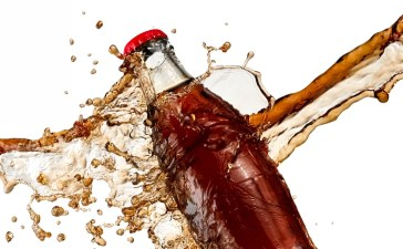 Soda bottle smashes against cold, hard reality. (Photo: Mariyana M/Shutterstock)