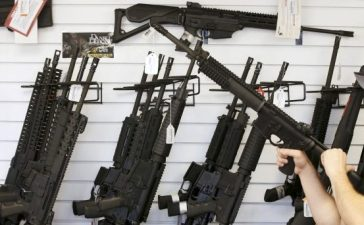 """FILE PHOTO - Salesman Ryan Martinez clears the chamber of an AR-15 at the """"Ready Gunner"""" gun store in Provo, Utah, June 21, 2016. REUTERS/George Frey/File Photo"""