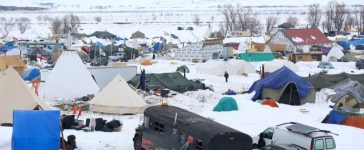 People walk through the Dakota Access Pipeline protest camp on the edge of the Standing Rock Sioux Reservation near Cannon Ball