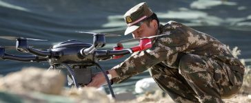 A police officer prepares a drone for display during a drill at a military base in Shigatse, Tibet Autonomous Region, China, October 25, 2015. REUTERS/Stringer