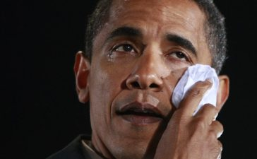 Barack Obama wipes a tear from his eye (REUTERS/Jason Reed)
