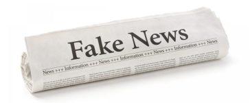 """Mainstream newspaper showing """"fake news."""" [Shutterstock - 556324534]"""