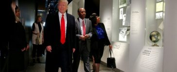 U.S. President Donald Trump and Ben Carson (C), his nominee to lead the Department of Housing and Urban Development (HUD), joined by Carson's wife, Candy Carson, look at the exhibit dedicated to Carson's distinguished career as a neurosurgeon during a visit to the National Museum of African American History and Culture on the National Mall in Washington, U.S., February 21, 2017. REUTERS/Jonathan Ernst