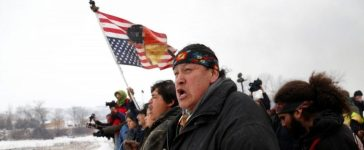 Raymond Kingfisher, 59, of the Northern Cheyenne Tribe, sings during a march on the outskirts of the main opposition camp against the Dakota Access oil pipeline near Cannon Ball, North Dakota, U.S., February 22, 2017. REUTERS/Terray Sylvester