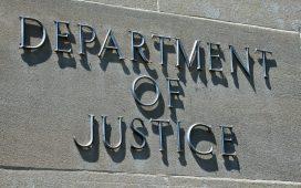 Department of Justice sign: shutterstock/Ken Kistler