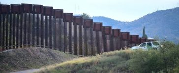A US Border Patrol vehicle parks beside a section of the US-Mexico border fence in Nogales, Arizona on October 12, 2016, across from Nogales, state of Sonora, Mexico. Since discovering the first drug tunnel in nearby Douglas, Arizona in 1990, border officials have found nearly 200 more along the 2,000 border in the Southwest, mostly in Arizona and California, with tunnels numerous in the Nogales area. FREDERIC J. BROWN/AFP/Getty Images