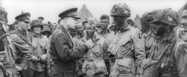 Allied forces Supreme Commander General Dwight D. Eisenhower speaks with U.S. Army paratroopers of Easy Company, 502nd Parachute Infantry Regiment (Strike) of the 101st Airborne Division, at Greenham Common Airfield in England June 5, 1944 in this handout photo provided by the US National Archives. US National Archives/Handout via Reuters