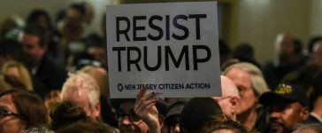 Resist Trump Sign: REUTERS/Stephanie Keith