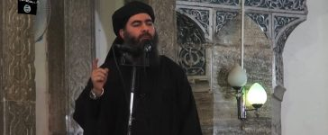 """This July 5, 2014 photo shows an image grab taken from a propaganda video released by al-Furqan Media allegedly showing the leader of the Islamic State (IS) jihadist group, Abu Bakr al-Baghdadi, aka Caliph Ibrahim, adressing Muslim worshippers at a mosque in the militant-held northern Iraqi city of Mosul. Baghdadi, who on June 29 proclaimed a """"caliphate"""" straddling Syria and Iraq, purportedly ordered all Muslims to obey him in the video released on social media. In early 2014 the self-styled Islamic State entered the northern Syrian city of Raqqa, declaring it their capital and beginning a reign of terror marked by grisly public executions. Armed sharia police patrolled the streets as """"enemies"""" of the regime were crucified or decapitated, their severed heads impaled on spikes in the city square. Student Abdalaziz Alhamza and his friends decided to form """"Raqqa is Being Silently Slaughtered"""" (RBSS), a band of courageous citizen journalists who risk their lives to document IS atrocities. AFP/Getty Images."""