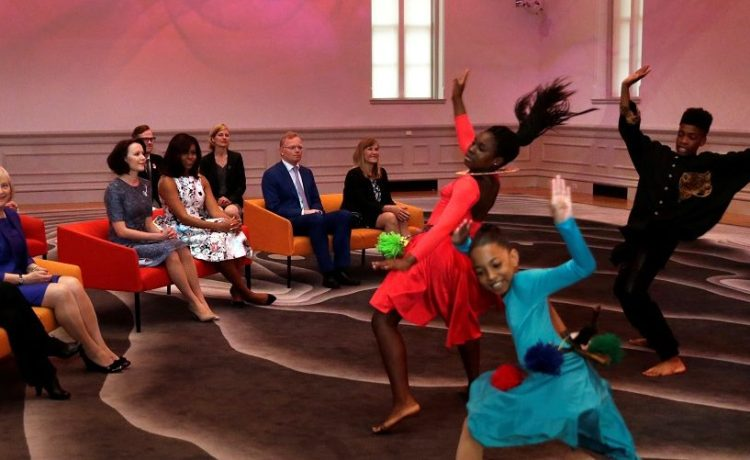 First lady Michelle Obama and spouses of Nordic Summit leaders watch a performance by the Savoy Elementary School students