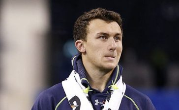 Former Texas A&M quarterback Johnny Manziel looks on as he sits out workouts during the 2014 NFL Combine at Lucas Oil Stadium on February 23, 2014 in Indianapolis, Indiana. (Photo by Joe Robbins/Getty Images)
