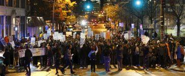 Demonstrators march during an anti-Islamophobia rally in Seattle, Washington, December 10, 2015. REUTERS/Jim Urquhart