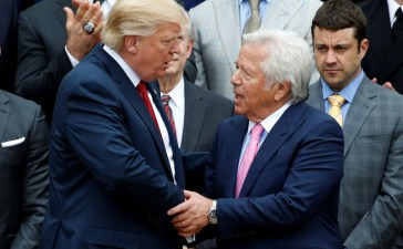 U.S. President Donald Trump shakes hands with CEO of the New England Patriots Robert Kraft during an event honoring the Super Bowl champion New England Patriots at the White House in Washington, U.S., April 19, 2017. REUTERS/Joshua Roberts