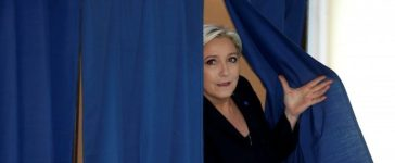 Marine Le Pen, French National Front (FN) political party leader and candidate for French 2017 presidential election, leaves a polling booth as she votes in the first round of 2017 French presidential election at a polling station in Henin-Beaumont. REUTERS/Pascal Rossignol