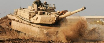 An Iraqi Army tanker with the 9th Armored Division drives an M1A1 Abrams tank under the instruction of Soldiers with Company C, 1st Battalion, 18th Infantry Regiment, 2nd Advise and Assist Brigade, 1st Infantry Division, United States Division-Center Jan. 16 at Camp Taji, Iraq. The IA tankers are preparing for a 45-day New Equipment Operator's Course this spring at the Besmaya Combat Training Center, Iraq. U.S. Army photo by Sgt. Chad Menegay, 196th MPAD, 25th Inf. Div., USD-C