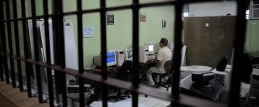 A prisoner works in a computer at the laboratory of the San Sebastian Prison in San Jose, on August 27, 2009. The San Sebastian Prison, which houses 653 prisoners including 150 foreigners, has installed a computer lab, and the titles of the computer courses obtained by inmates will be recognized officially, told the director of the prison Mariano Barrantes. (Photo credit: YURI CORTEZ/AFP/Getty Images)