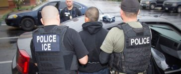 U.S. Immigration and Customs Enforcement (ICE) officers detain a suspect. (PHOTO: Charles Reed/U.S. Immigration and Customs Enforcement)