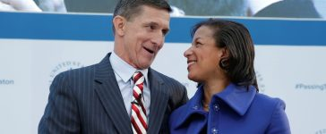 """White House National Security Adviser Susan Rice (R) and former Defense Intelligence Agency Director retired Army Lt. Gen. Michael Flynn, incoming White House national security adviser, shake hands at the U.S. Institute of Peace """"2017 Passing the Baton"""" conference in Washington, January 10, 2017. REUTERS/Yuri Gripas"""