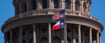 The U.S flag and the Texas State flag fly over the Texas State Capitol as the state senate debates the #SB6 bathroom bill in Austin, Texas, U.S., March 14, 2017. (PHOTO: REUTERS/Brian Snyder)
