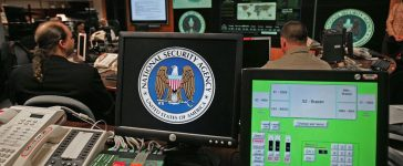 Fort Meade, UNITED STATES: A computer workstation bears the National Security Agency (NSA) logo inside the Threat Operations Center. (Photo credit: PAUL J. RICHARDS/AFP/Getty Images)