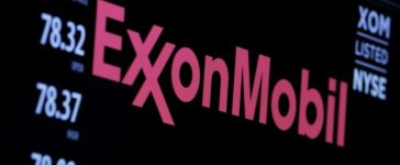 The logo of Exxon Mobil Corporation is shown on a monitor above the floor of the New York Stock Exchange in New York, December 30, 2015. (REUTERS/Lucas Jackson)