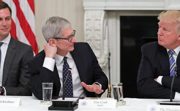 """Apple CEO Tim Cook delivers brief remarks as U.S. President Donald Trump (R) and White House Director of the Office of American Innovation and the president's son-in-law Jared Kushner listen during a meeting of the American Technology Council in the State Dining Room of the White House June 19, 2017 in Washington, DC. According to the White House, the council's goal is """"to explore how to transform and modernize government information technology."""" (Photo by Chip Somodevilla/Getty Images)"""