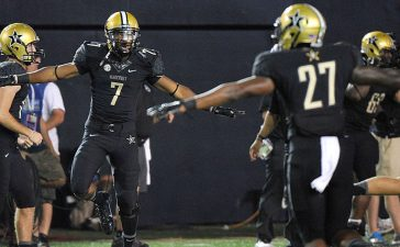 Emmanuel Smith #7 and Jahmel McIntosh #27 of the Vanderbilt Commodores celebrate after a touchdown against the South Carolina Gamecocks during the second half of a game at Vanderbilt Stadium on September 20, 2014 in Nashville, Tennessee. (Photo by Frederick Breedon/Getty Images)