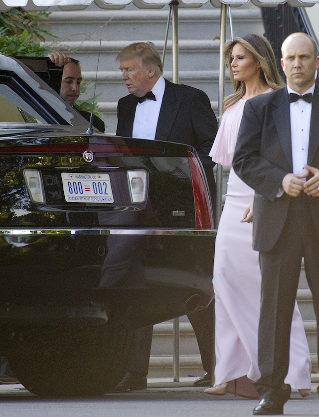 WASHINGTON, DC - JUNE 24: United States President Donald J. Trump and first lady Melania Trump depart the White House in Washington, DC on June 24, 2017. The Trumps left to attend the wedding of US Secretary of the Treasury Steven Mnuchin and Louise Linton. The first lady is wearing a Gilles Mendel silk chiffon gown with Manolo Blahnik pumps. ( Photo by Ron Sachs-pool/Getty Images)