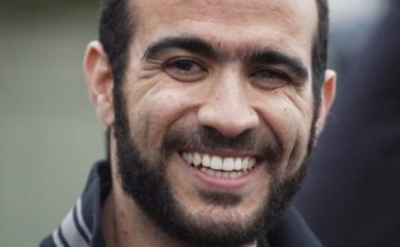 FILE PHOTO: Omar Khadr smiles as he answers questions during a news conference after being released on bail in Edmonton, Alberta, May 7, 2015. Khadr, a Canadian, was once the youngest prisoner held on terror charges at Guantanamo Bay. REUTERS/Dan Riedlhuber/File Photo