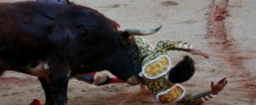 Spanish bullfighter Alberto Lopez Simon gets gored by a bull during a bullfight at the San Fermin festival in Pamplona, northern Spain July 12, 2017. REUTERS/Susana Vera
